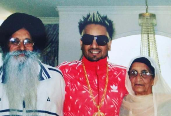 Jazzy B with his parents