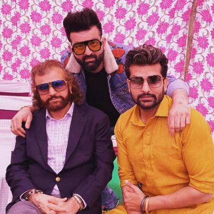Yuvraj Hans with his father and brother