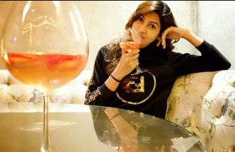 Sangeita Chauhaan with a glass of wine