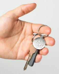 StarCharm personalized natal chart key fob shown in a person's hand