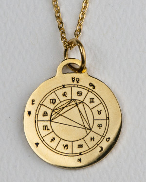 Gold-colored StarCharm personalized pendant engraved with the wearers astrological natal chart