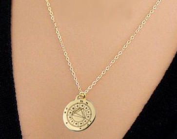 woman wearing personalized StarCharm pendant engraved with her astrological natal chart