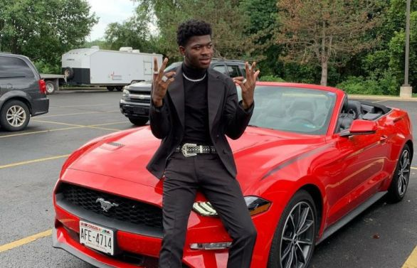 Lil Nas X with his car