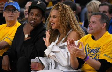Beyonce with her husband in a basket ball championships