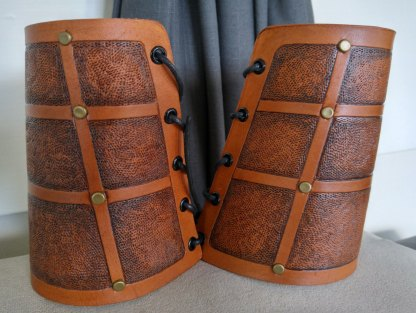 Rivet-accented short leather bracers
