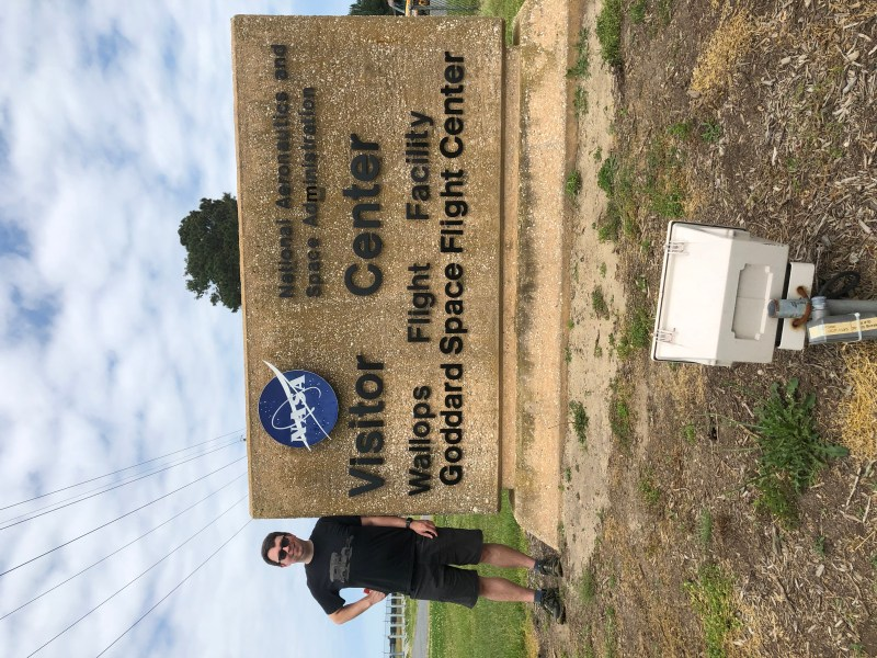 Standing by the NASA visitor center sign