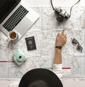 Female traveler pointing on map