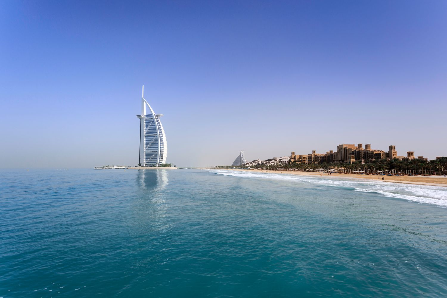 The Burj Al Arab with the ocean in the foreground