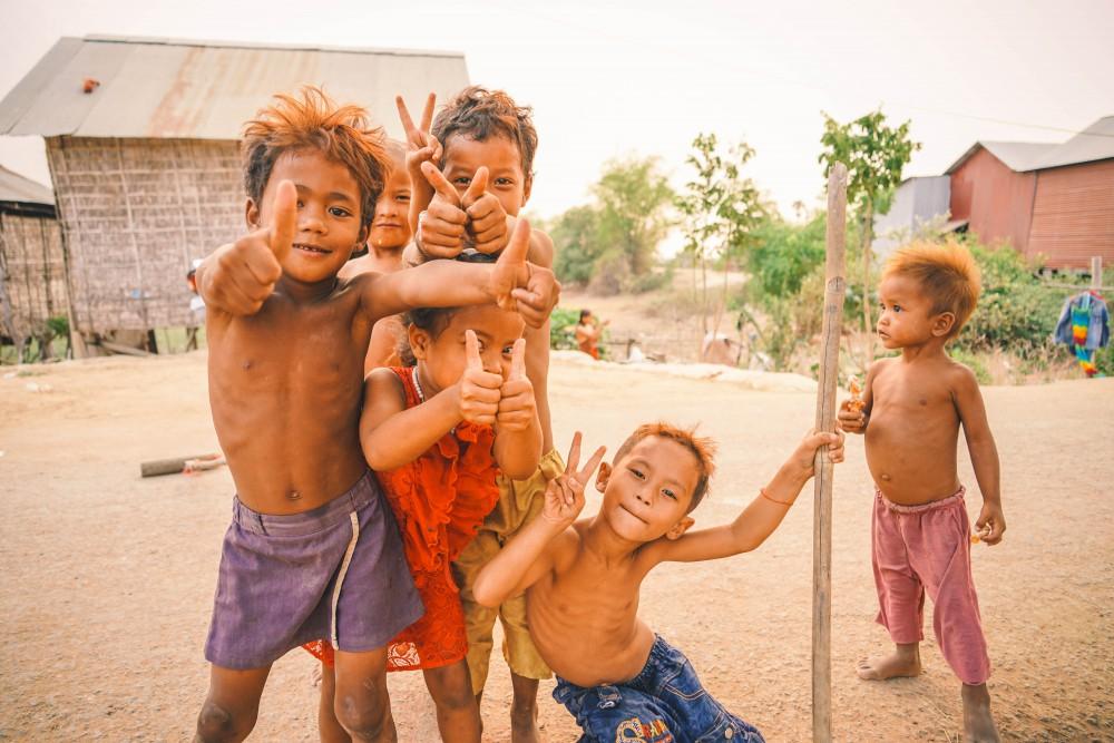 Poverty-stricken Asian boys posing for the camera