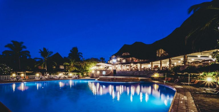 Temple Point Resort swimming pool at night.
