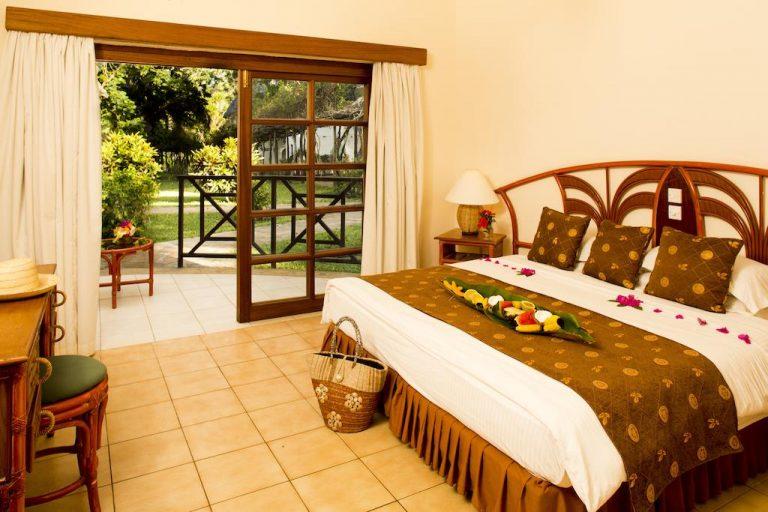 A room at Neptune Village Beach Resort & Spa.