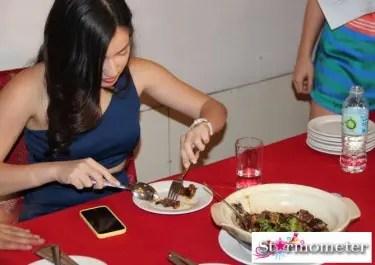Joyce Trying the Secret Dish No 2