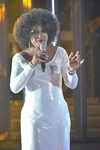 Nyoy Volante performing as Whitney Houston at Your Face Sounds Familiar's Grand Showdown