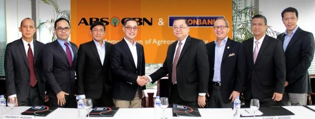 (L-R) ABS-CBN officials: Ricardo B. Tan, Jr., ABS-CBN Treasury head, Aldrin M. Cerrado, chief financial officer, Rolando P. Valdueza, Group CFO & head of Corporate Services Group, Carlo L. Katigbak, president & CEO; UnionBank officials: Edwin R. Bautista, president and COO, Eugene S. Acevedo, senior executive vice president, Retail and Corporate Banking head, Frederick E. Claudio, senior vice president, Corporate Banking Center head, and John L. Cary Ong, senior vice president, Transaction Banking Center head.