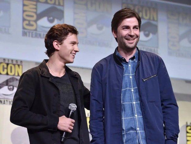 """SAN DIEGO, CA - JULY 23: Actor Tom Holland (L) and director Jon Watts from Marvel Studios? """"Spider-Man: Homecoming? attend the San Diego Comic-Con International 2016 Marvel Panel in Hall H on July 23, 2016 in San Diego, California. ©Marvel Studios 2016. ©2016 CTMG. All Rights Reserved.  (Photo by Alberto E. Rodriguez/Getty Images for Disney)"""