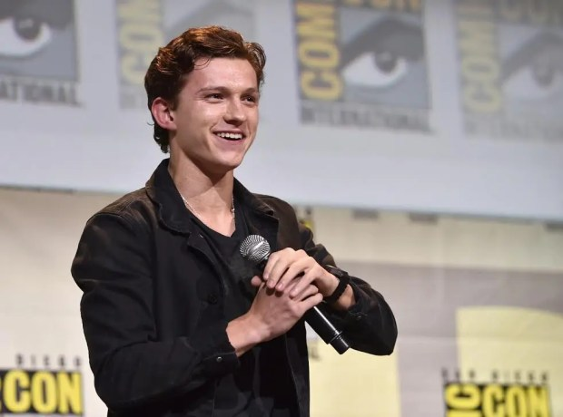 """SAN DIEGO, CA - JULY 23:  Actor Tom Holland from Marvel Studios? """"Spider-Man: Homecoming? attends the San Diego Comic-Con International 2016 Marvel Panel in Hall H on July 23, 2016 in San Diego, California. ©Marvel Studios 2016. ©2016 CTMG. All Rights Reserved.  (Photo by Alberto E. Rodriguez/Getty Images for Disney)"""