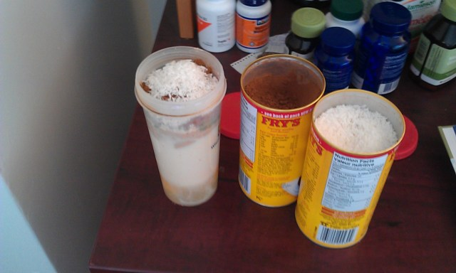 (Protein shake meal replacement = rice protein, hemp protein, cacao,(sometimes berries as featured in these pictures, but they were a rare festivity), ground flax seeds, shredded coconut, 2 eggs and soy milk. Roughly 40g of protein – probably around 400-500 calories)