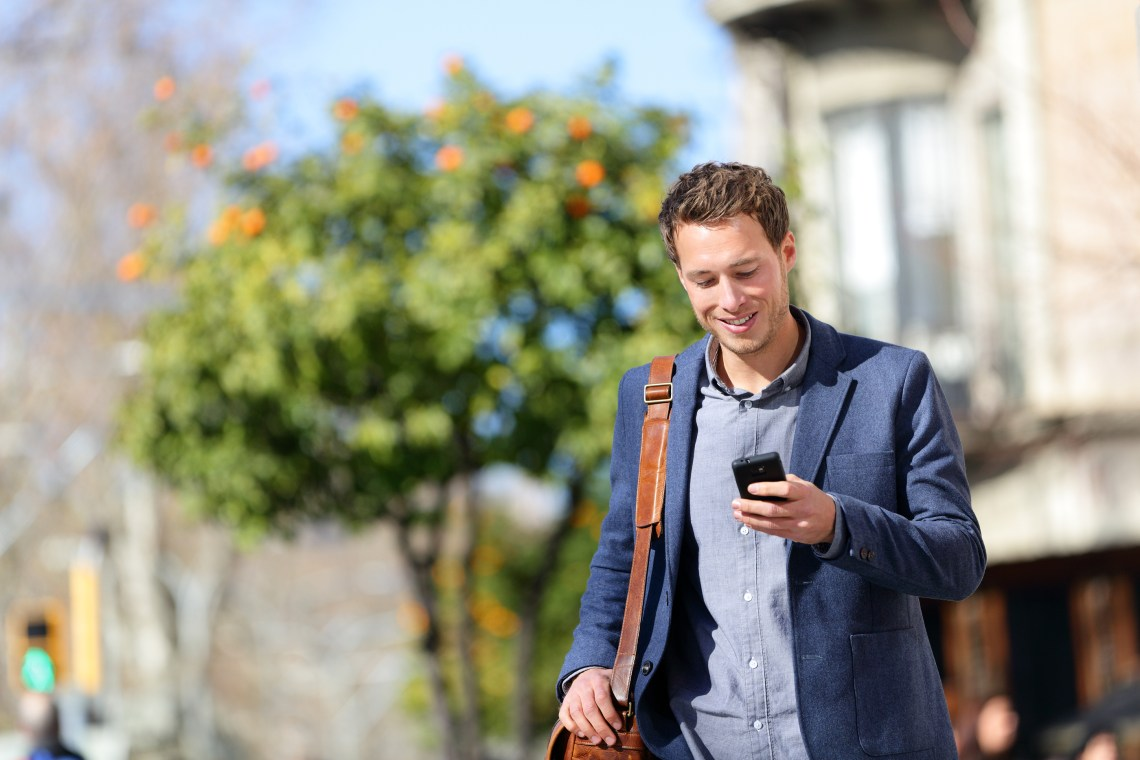 mobility young urban professional man using a smartphone