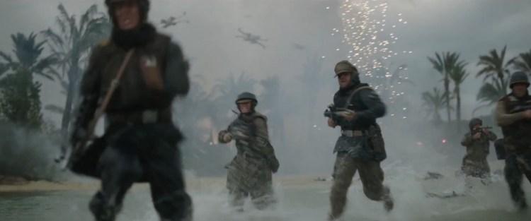 We zien Rebel Alliance soldaten op het strand uit een U-Wing springen, door het water rennen terwijl er een aantal X-Wings langs vliegen en ze onder vuur liggen.