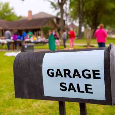 Start paying off debt using proceeds from garage sale