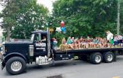 Girl Scouts enjoy a ride from Halfmoon Valley Towing at the Central PA 4th Fest Parade of Heroes