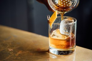 a whiskey cocktail is poured