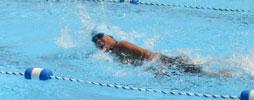 person swimming laps