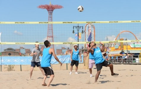 men play volleyball on the beach at Coney Island