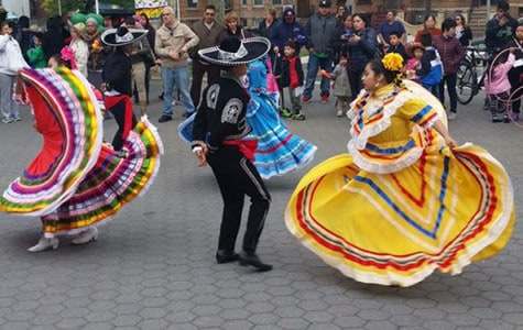 Mexican dancers perform in a park