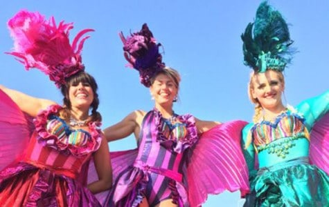 performers dressed in colorful outfits
