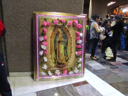 A flower-laced image inside the Basilica of Our Lady of Guadalupe. Source: Chris Crews (Attribution via chriscrews.com)