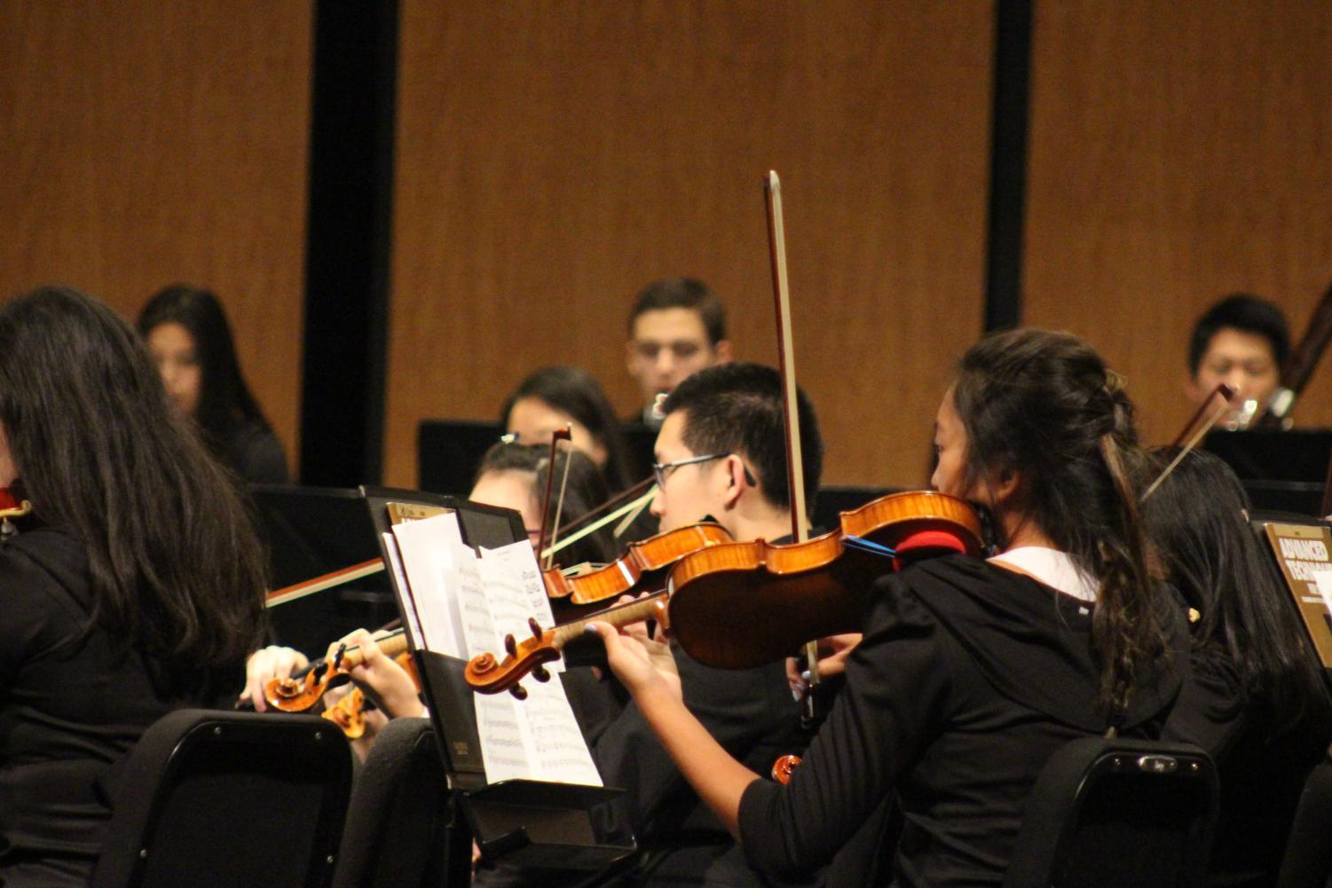 Adele Lee '19 and and Andrew Ding '19 perform during the fall orchestra concert. Lee and Ding are members of Patriot Orchestra.