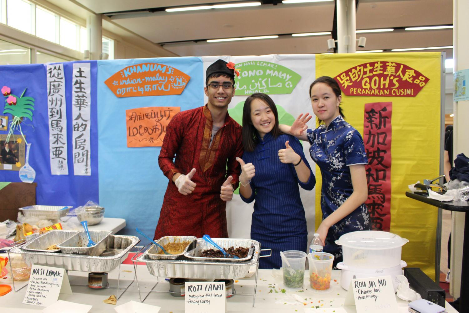 Shisir Bandapalli '21, Diane Bi '21, and Clare Hu '21 all helped out at the Malaysian booth.  They were all eager to share Malaysian cuisine: Nasi lemak, roti lani, and rou jia mo.