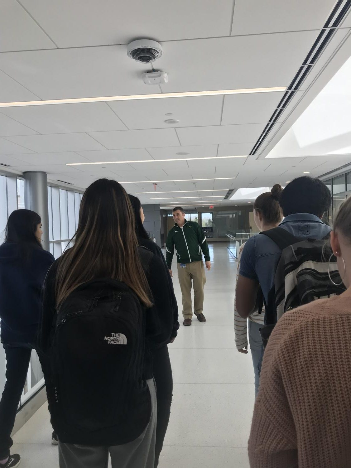 Students follow Mr.Gobble one of the main hallways of the new addition to the East Building. Classes are set to start in the new addition in fall of 2019. 