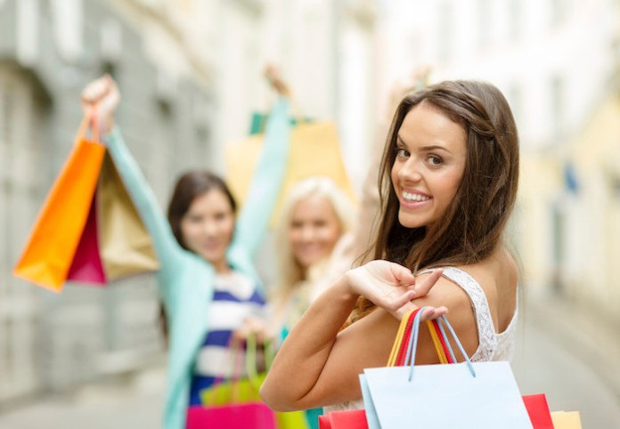 beautiful woman with shopping bags in the ctiy (google image)