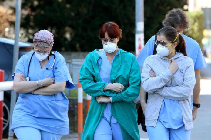 People and health workers wear protective face masks outside the hospital in Padua, Veneto region, northern Italy, 22 February 2020. A second person in Italy has died after being infected with the coronavirus. The death of a woman in the northern region of Lombardy follows that of a 78-year-old man who died on Friday. The new wave of cases in Italy's northern regions have triggered shut-downs of shops, offices and community centres. ANSA/NICOLA FOSSELLA