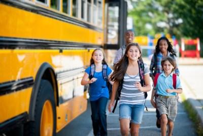 Elementary kids taking the school bus