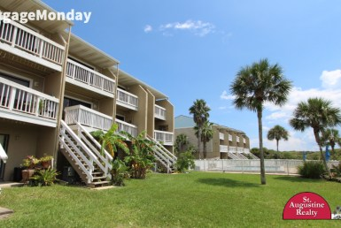 "View of condos from the ground with the text ""# Mortgage Monday"" in the top left corner"