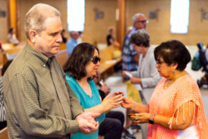 Image of a couple receiving communion