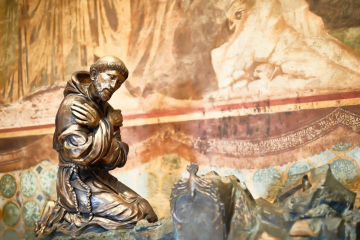 Sculpture of St. Francis of Assisi, artist unknown, Upper Church in the Basilica of Saint Francis of Assisi, Assisi, Italy; photo by K505/Shutterstock.