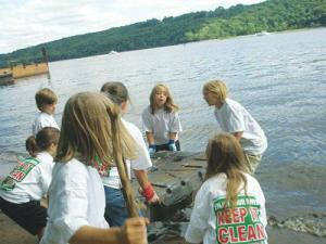 Kids cleaning up the river