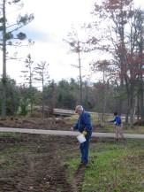 Citizen stewards spreading native seeds at Riverside Landing on 10/14.