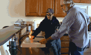 """A man lights his tap water on fire to demonstrate pollution from natural gas """"fracking"""""""