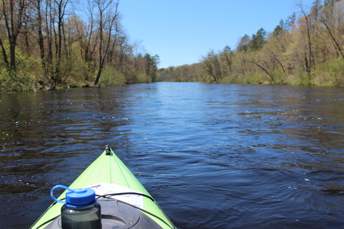 View of river from seat of a kayak