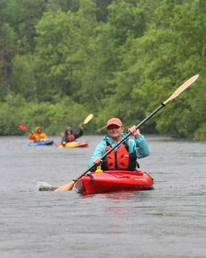 St. Croix River Association executive director Deb Ryun kayaks down the Namekagon during the 2013 paddle.