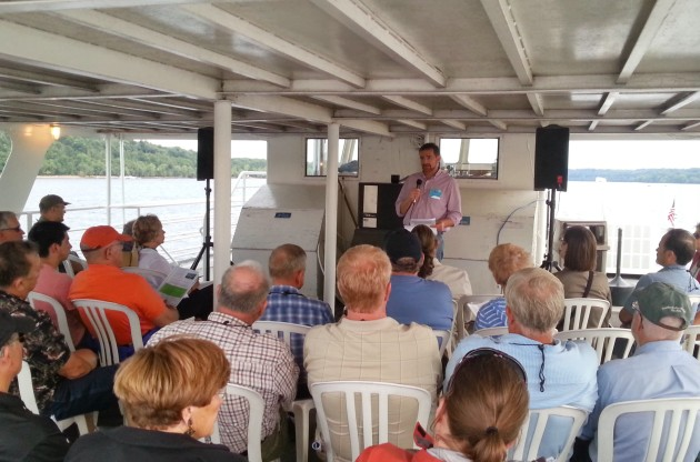 Mike Isensee, dministrator of the Middle St. Croix Watershed Management Organization, speaks at a breakout session on the top deck of the Grand Duchess. (Greg Seitz, St. Croix 360)