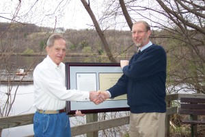 Jack Pattie receives the Department of Interior's Meritorious Service Award in 2003 from Assistant Regional Director David Given.