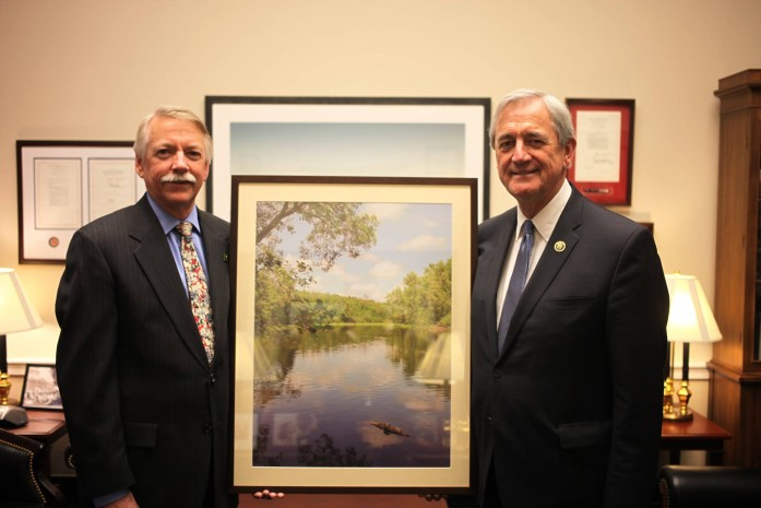 National Park Service director Jon Jarvis (left) presents a photo of the St. Croix River to Minnesota Representative Rick Nolan.