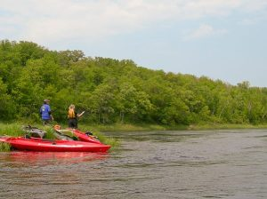 Fly fishing on a St. Croix River island. (Photo via National Park Service)