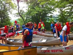 Racers in the 2014 Fat Cat Triathlon start the canoe race.